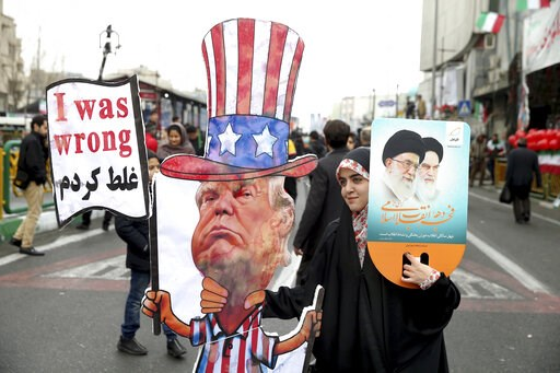 (AP Photo/Ebrahim Noroozi, File). FILE - In a Feb. 11, 2019 file photo, an Iranian woman holds an effigy of US president Donald Trump, during a rally marking the 40th anniversary of the 1979 Islamic Revolution, in Tehran, Iran. Iranian President Hassan...