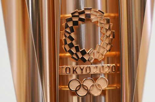 (AP Photo/Eugene Hoshiko, File). FILE - This March 20, 2019, file photo shows the emblem of the Olympic torch of the Tokyo 2020 Olympic Games during a press conference in Tokyo. Tokyo organizers said Wednesday, May 8, 2019, they are trying to cut spend...