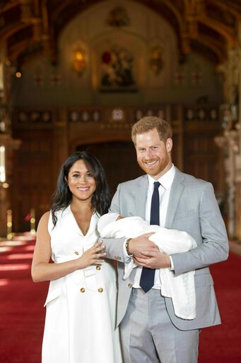 (Dominic Lipinski/Pool via AP). Britain's Prince Harry and Meghan, Duchess of Sussex, during a photocall with their newborn son, in St George's Hall at Windsor Castle, Windsor, south England, Wednesday May 8, 2019. Baby Sussex was born Monday at 5:26 a...