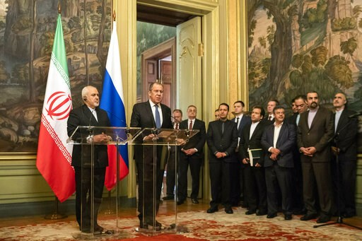(AP Photo/Pavel Golovkin). Russian Foreign Minister Sergey Lavrov and Iranian Foreign Minister Mohammad Javad Zarif, left, attend a news conference during their meeting in Moscow, Russia, Wednesday, May 8, 2019.