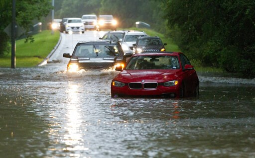 (Jason Fochtman/Houston Chronicle via AP). Vehicles wade through flooded Kingwood Drive as thunderstorms hit the Kingwood area Tuesday, May 7, 2019, in Kingwood, Texas. Heavy rain is battering parts of southeast Texas prompting flash flood warnings, po...