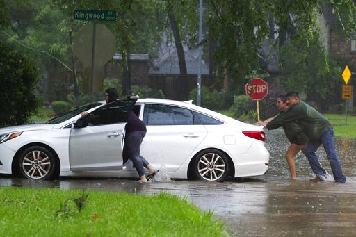 (Jason Fochtman/Houston Chronicle via AP). Residents push a stalled car as thunderstorms hit the Kingwood area flooding parts of Kingwood Drive, Tuesday, May 7, 2019, in Kingwood, Texas. Heavy rain is battering parts of southeast Texas prompting flash ...