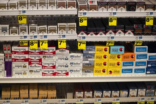 (AP Photo/Jae C. Hong). Cigarettes are displayed on store shelves Tuesday, May 7, 2019, in Beverly Hills, Calif. Beverly Hills is considering outlawing the sale of tobacco products, a move that would make the glamorous California city the first in the ...