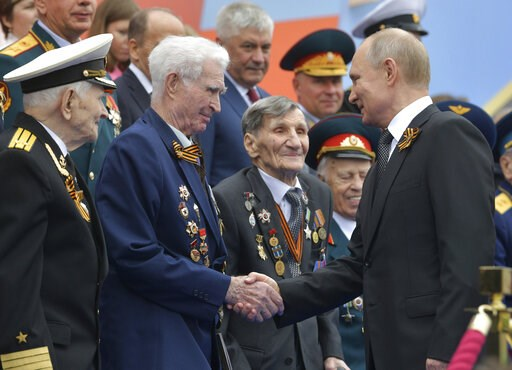 (Alexei Druzhinin, Sputnik, Kremlin Pool Photo via AP). Russian President Vladimir Putin shakes hands with WWII veterans prior to a military parade marking 74 years since the victory in WWII in Red Square in Moscow, Russia, Thursday, May 9, 2019.