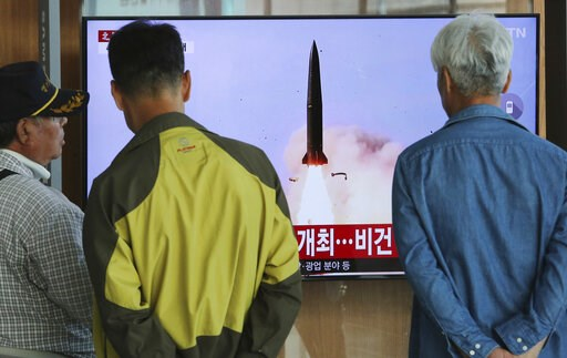 (AP Photo/Ahn Young-joon). People watch a TV showing a file photo of North Korea's weapon systems during a news program at the Seoul Railway Station in Seoul, South Korea, Thursday, May 9, 2019. North Korea on Thursday fired at least one unidentified p...