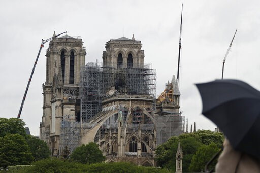 (AP Photo/Thibault Camus). Cranes work at Notre Dame cathedral, in Paris, Thursday, April 25, 2019. French police scientists were starting to examine Notre Dame Cathedral on Thursday for the first time since last week's devastating fire.