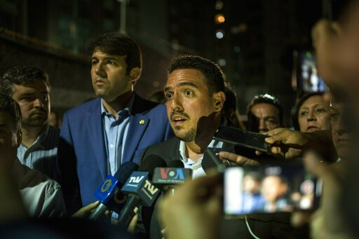 (AP Photo/Rodrigo Abd). Opposition Deputy of the National Assembly Stalin Gonzalez talks to journalists at the Democratic Action political party headquarters in Caracas, Venezuela, Wednesday, May 8, 2019, after National Assembly Vice President Edgar Za...