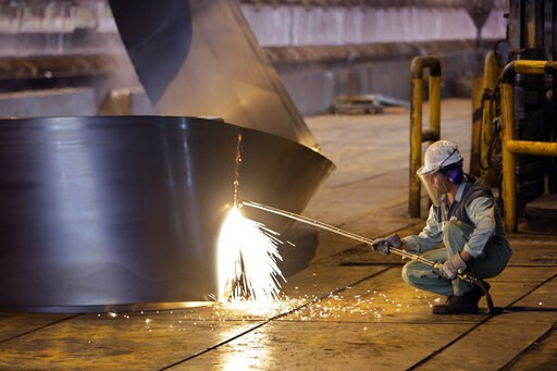 (AP Photo/Vahid Salemi, File). FILE - In this May 31, 2012 file photo, an Iranian worker cuts a steel roll at the Mobarakeh Steel Complex, some 280 miles (460 kilometers) south of the capital Tehran, and some 40 miles, 65 kilometers, southwest of centr...