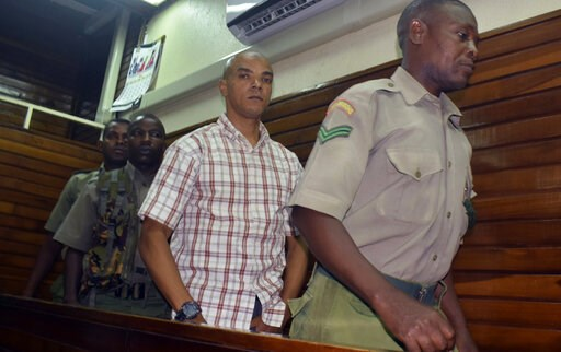 (AP Photo). Guarded by heavy security, British suspect Jermaine Grant, centre, walks out of a Mombasa court after being sentenced, in Mombasa, Kenya, Thursday, May 9, 2019, A Kenyan court has jailed a British national believed to be part of an extremis...