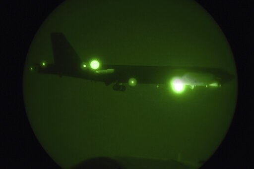 (Staff Sgt. Ashley Gardner/U.S. Air Force via AP). In this Thursday, May 9, 2019 photo released by the U.S. Air Force, a B-52H Stratofortress assigned to the 20th Expeditionary Bomb Squadron is seen through night vision coming in for a landing at Al Ud...