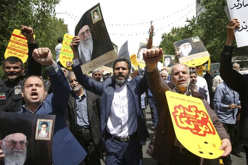 (AP Photo/Ebrahim Noroozi). Worshippers chant slogans against the United States and Israel during a rally after Friday prayers in Tehran, Iran, Friday, May 10, 2019. A top commander in Iran's powerful Revolutionary Guard said Friday that Tehran will no...