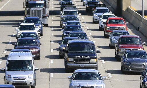 (AP Photo/Carlos Osorio, File). FILE- In a June 23, 2015, file photo, traffic heads north along the Lodge freeway in Detroit. Michigan, the state with the highest car insurance premiums in the country, is on the verge of a political showdown over long-...
