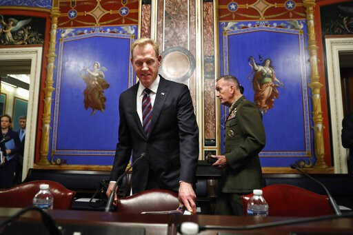 (AP Photo/Jacquelyn Martin). Acting Defense Secretary Patrick Shanahan, left, and Joint Chiefs Chairman Gen. Joseph Dunford, arrive to testify at a Senate Appropriations subcommittee hearing on the defense budget, Wednesday May 8, 2019, on Capitol Hill...