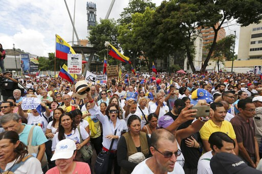 (AP Photo/Fernando Llano). Opponents of Nicolas Maduro's government attend a rally led by opposition leader Juan Guaidó, in Caracas, Venezuela, Saturday, May 11, 2019. Guaidó has called for nationwide marches protesting the Maduro government, demanding...
