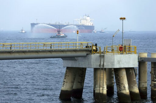 (AP Photo/Kamran Jebreili). FILE - In this Sept. 21, 2016 file photo, an oil tanker approaches to the new Jetty during the launch of the new $650 million oil facility in Fujairah, United Arab Emirates. The United Arab Emirates said Sunday, May 12, 2019...