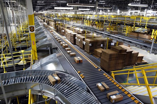 (AP Photo/Patrick Semansky, File). FILE- In this Aug. 3, 2017, file photo, packages ride on a conveyor system at an Amazon fulfillment center in Baltimore. Amazon, which is racing to deliver packages faster, is turning to its employees with a propositi...