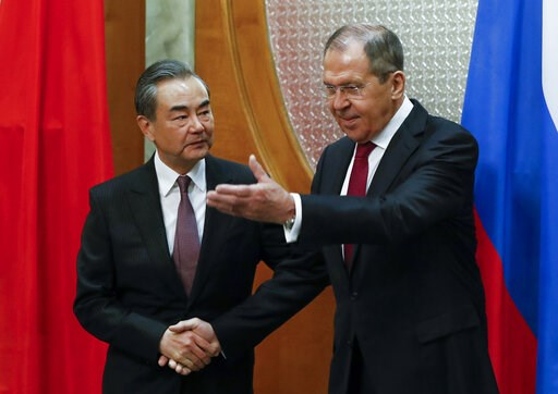 (AP Photo/Pavel Golovkin, Pool). Russian Foreign Minister Sergey Lavrov, right, welcomes Chinese Foreign Minister Wang Yi for the talks in Sochi, Russia, Monday, May 13, 2019.