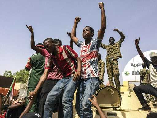 (AP Photo, File). FILE - In this April 11, 2019  file photo, Sudanese celebrate after officials said the military had forced longtime autocratic President Omar al-Bashir to step down after 30 years in power in Khartoum, Sudan. As the uprising against S...