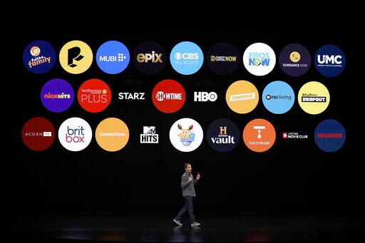 (AP Photo/Tony Avelar, File). FILE - In this March 25, 2019, file photo Peter Stern, Apple Vice President of Services, speaks at the Steve Jobs Theater during an event to announce new products in Cupertino, Calif. Apple users will be able to subscribe ...