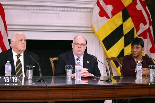 (AP Photo/Brian Witte). Maryland Gov. Larry Hogan highlights bipartisan efforts to improve health care in Maryland before signing legislation to help uninsured residents get health insurance and to raise the smoking age from 18 to 21 on Monday, May 13,...