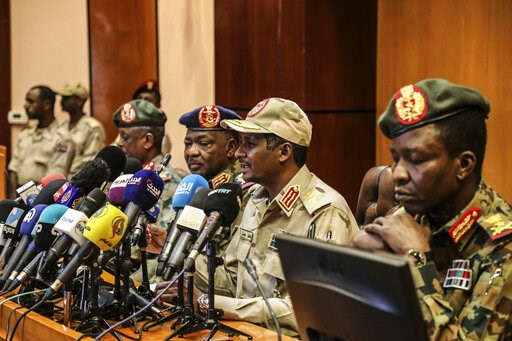 (AP Photo). FILE - In this April 30, 2019 file photo, Gen. Mohamed Hamdan Dagalo, the deputy head of the military council, second right, speaks at a press conference in Khartoum, Sudan. As the uprising against Sudanese President Omar al-Bashir gained s...