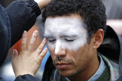 (AP Photo/Elaine Thompson, File). FILE - In this Oct. 31, 2018, file photo, a man, who declined to be identified, has his face painted to represent efforts to defeat facial recognition during a protest at Amazon headquarters over the company's facial r...