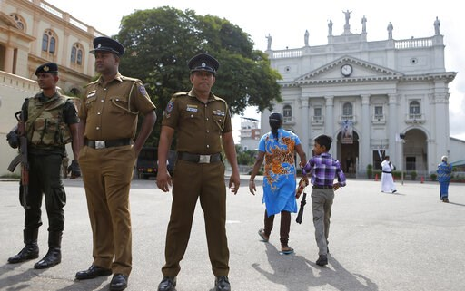 (AP Photo/Eranga Jayawardena). In this Sunday, May 12, 2019, photo, Sri Lankan soldiers stand guard at the entrance to Good Shepherd convent and the St. Benedict's college in Colombo, Sri Lanka. Catholic officials and parents in Sri Lanka are hopeful t...