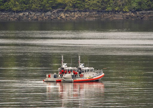 (Dustin Safranek/Ketchikan Daily News via AP). Two U.S. Coast Guard 45-foot response boats drift through George Inlet as part of a search effort on Tuesday, May 14, 2019, near Ketchikan, Alaska, at the site of a collision between two float planes. Dive...