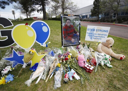 (AP Photo/David Zalubowski). A display grows outside the STEM School Highlands Ranch a week after the attack on the school that left one student dead and others injured, Tuesday, May 14, 2019, in Highlands Ranch, Colo. Student Kendrick Castillo picture...