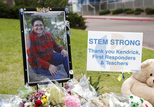 (AP Photo/David Zalubowski). A photograph of student Kendrick Castillo stands amid a display of tributes outside the STEM School Highlands Ranch a week after the attack on the school that left Castillo dead and others injured, Tuesday, May 14, 2019, in...