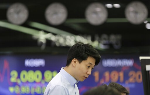 (AP Photo/Lee Jin-man). A currency trader watches the computer monitors near the screens showing the Korea Composite Stock Price Index (KOSPI), left, and the foreign exchange rate between U.S. dollar and South Korean won at the foreign exchange dealing...