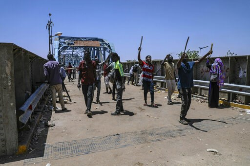 (AP Photo). Protesters walk towards the sitin protest outside the Sudanese military headquarters, in Khartoum, Sudan, Tuesday, May 14, 2019. Sudanese protesters say security agents loyal to ousted President Omar al-Bashir attacked their sit-ins overnig...