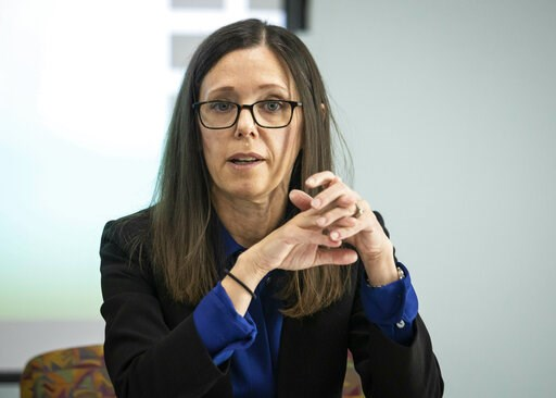(Ashlee Rezin/Sun Times via AP)/Chicago Sun-Times via AP). In this May 13, 2019 photo, Dana Weiner, policy fellow at Chapin Hall at the University of Chicago, discusses a review of the Illinois Department of Children and Family Services' Intact Family ...