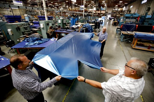 (AP Photo/Chris Carlson, File). FILE - In this July 5, 2018, file photo workers assemble the Afloat water mattresses at the factory in Corona, Calif. On Wednesday, May 15, 2019, the Federal Reserve reports on U.S. industrial production for April.