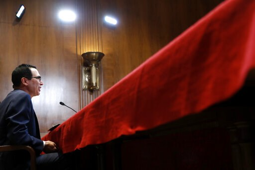 (AP Photo/Jacquelyn Martin). Treasury Secretary Steve Mnuchin testifies about the budget to a Financial Services and General Government subcommittee, Wednesday May 15, 2019, on Capitol Hill in Washington.
