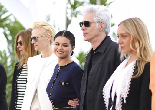 (Photo by Arthur Mola/Invision/AP). Actors Sara Driver, from left, Tilda Swinton, Selena Gomez, director Jim Jarmusch and actress Chloe Sevigny pose for photographers at the photo call for the film 'The Dead Don't Die' at the 72nd international film fe...