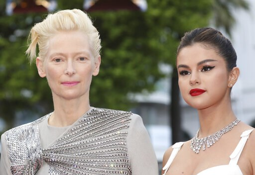 (Photo by Vianney Le Caer/Invision/AP). Actresses Tilda Swinton, left, and Selena Gomez pose for photographers upon arrival at the opening ceremony and the premiere of the film 'The Dead Don't Die' at the 72nd international film festival, Cannes, south...