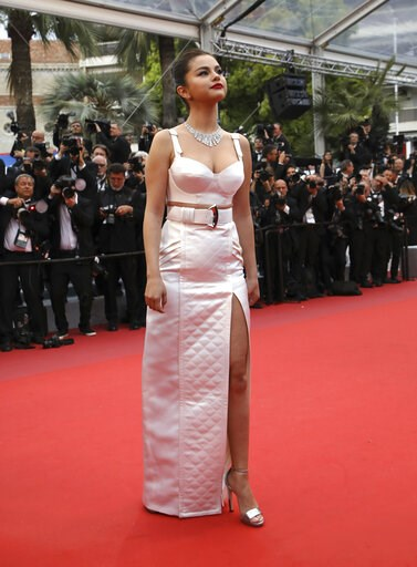 (Photo by Vianney Le Caer/Invision/AP). Actress Selena Gomez poses for photographers upon arrival at the opening ceremony and the premiere of the film 'The Dead Don't Die' at the 72nd international film festival, Cannes, southern France, Tuesday, May 1...