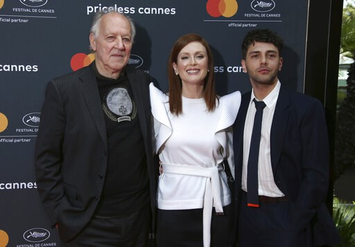 (Photo by Joel C Ryan/Invision/AP). Director Werner Herzog, from left, actress Julianne Moore and Xavier Dolan pose for photographers at the See The World Through A Different Lens photo call at the 72nd international film festival, Cannes, southern Fra...