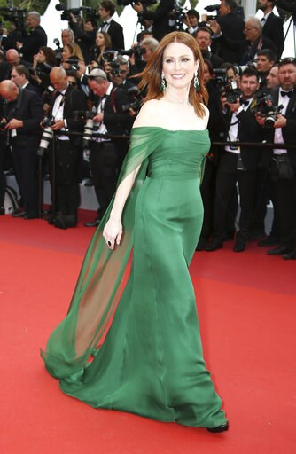 (Photo by Joel C Ryan/Invision/AP). Actress Julianne Moore poses for photographers upon arrival at the opening ceremony and the premiere of the film 'The Dead Don't Die' at the 72nd international film festival, Cannes, southern France, Tuesday, May 14,...