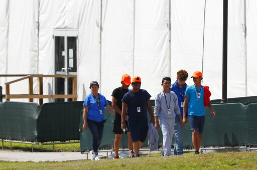 (AP Photo/Wilfredo Lee, File). FILE - In this Monday, May 6, 2019 file photo, migrant children walk outside the Homestead Temporary Shelter for Unaccompanied Children in Homestead, Fla. The U.S. government is providing long-distance video counseling to...
