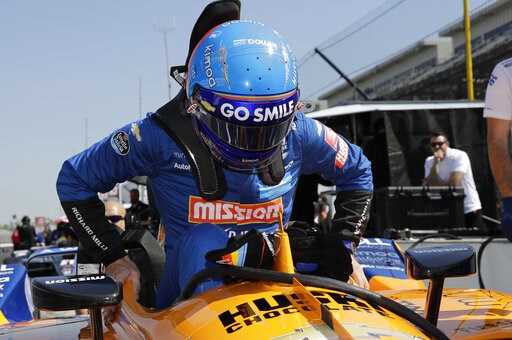 (AP Photo/Darron Cummings). Fernando Alonso, of Spain, climbs into his car to practice for the Indianapolis 500 IndyCar auto race at Indianapolis Motor Speedway, Tuesday, May 14, 2019, in Indianapolis.