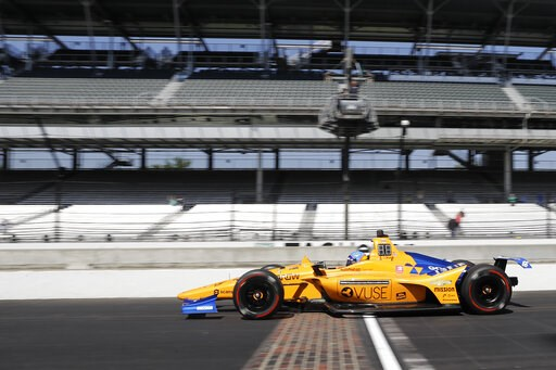 (AP Photo/Darron Cummings). Fernando Alonso, of Spain, leaves the pits during practice for the Indianapolis 500 IndyCar auto race at Indianapolis Motor Speedway, Tuesday, May 14, 2019, in Indianapolis.