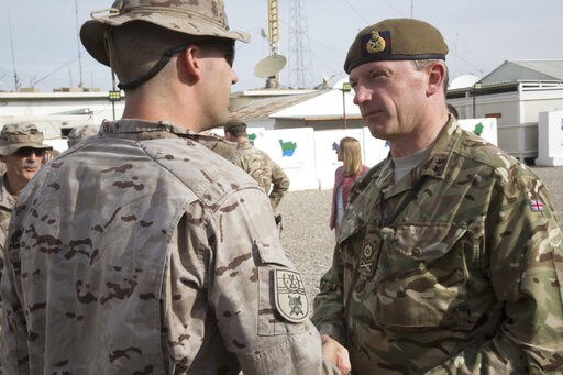 (Spc. Eric Cerami/U.S. Army via AP). In this Nov. 22, 2018, photo, British army Maj. Gen. Christopher Ghika, deputy commander for Strategy and Information, Combined Joint Task Force - Operation Inherent Resolve (CJTF-OIR), shakes hands with a Spanish s...
