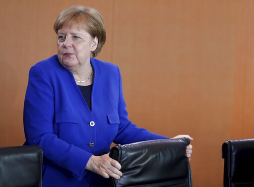 (AP Photo/Michael Sohn). German Chancellor Angela Merkel arrives for the weekly cabinet meeting at the chancellery in Berlin, Germany, Wednesday, May 15, 2019.