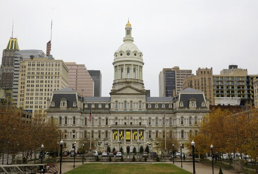 (AP Photo/Patrick Semansky). This Dec. 6, 2016, photo shows the City Hall building from the steps of the War Memorial Building in Baltimore. More than a week after a cyberattack hobbled Baltimore's computer network, city officials said Wednesday, May 1...