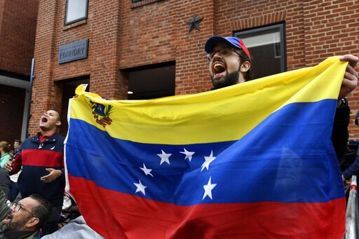 (AP Photo/Susan Walsh). Protester Andres Miguel Harris, who was born in Venezuela, protests with other outside the Venezuelan embassy in Washington, Tuesday, May 14, 2019.