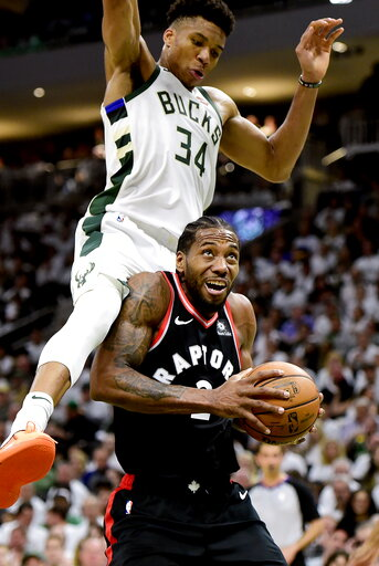 (Frank Gunn/The Canadian Press via AP). Toronto Raptors forward Kawhi Leonard (2) is fouled by Milwaukee Bucks forward Giannis Antetokounmpo (34) during the second half in Game 1 of the NBA basketball playoffs Eastern Conference final in Milwaukee on W...
