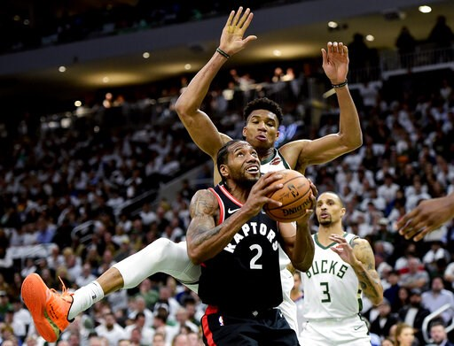 (Frank Gunn/The Canadian Press via AP). Toronto Raptors forward Kawhi Leonard (2) gets fouled by Milwaukee Bucks forward Giannis Antetokounmpo (34) during the second half in Game 1 of the NBA basketball playoffs Eastern Conference final in Milwaukee on...