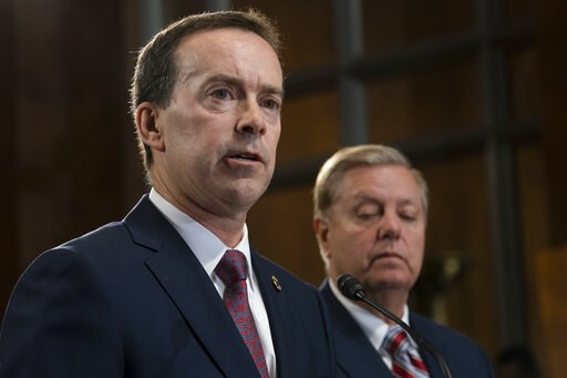 (AP Photo/J. Scott Applewhite). Acting U.S. Customs and Border Protection Commissioner John Sanders, left, joins Senate Judiciary Committee Chairman Lindsey Graham, R-S.C., right, an ally of President Donald Trump, as Graham announces his proposal to r...